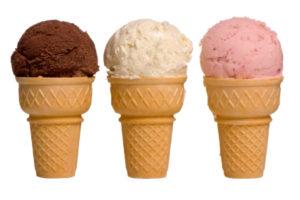 3 different flavors of ice cream cones... chocolate, vanilla, and strawberry